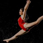 Dancer in red splits